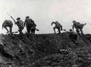 """British soldiers going """"Over the top"""" climbing out of their trench on July 1, 1916. Credit The Daily Mail"""